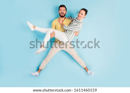 Top view above high angle flat lay flatlay lie concept full length body size view of nice cheery spouses carrying girl having fun isolated on bright vivid shine vibrant blue turquoise color background #1611460159