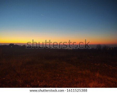 Sunset on the horizon in Serbia  #1611525388