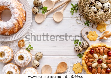 Easter background with  mazurek pastry, yeast cakes and quail eggs on rustic white wooden background, top view, copy space. Traditional easter #1611529966