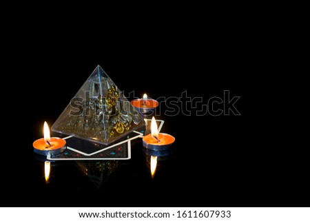 Fortune-telling, astrology, mystical. A card reading at night with candles and magic pyramid #1611607933