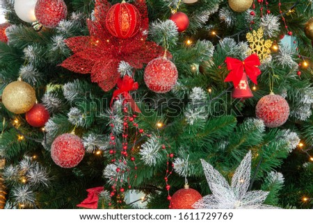 Festive background image of a Christmas tree with toys and lights 2020 New Year. Green texture with red glass balls with place for text