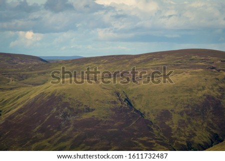 View looking east above Glen Doll towards upland Scottish mounta #1611732487