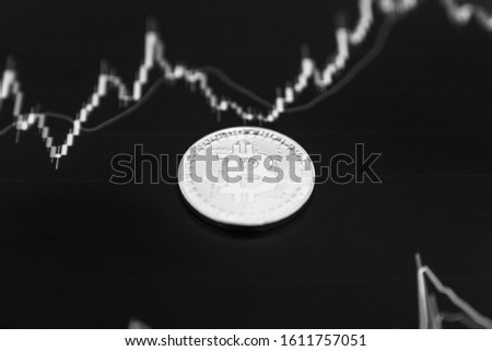 Bitcoin on the black graph. New online currency. Currency of the future. #1611757051