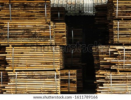 Processed lumber packed and stacked and drying on air. #1611789166