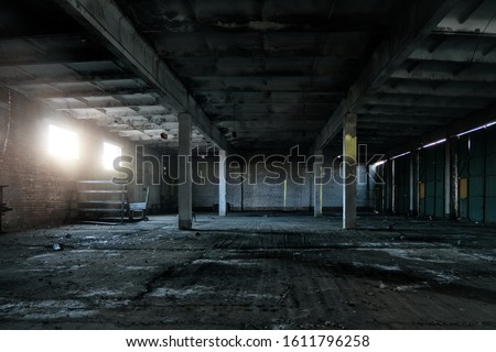 Old abandoned industrial building interior #1611796258
