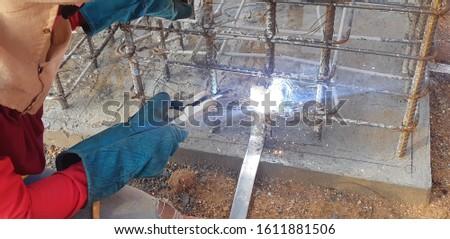 Workers are welding steel . #1611881506