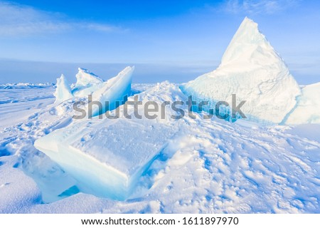Arctic background. North pole. Beautiful colors of polar ice. Big Floes. Glaciers. Snowy landscape on blue sky and sunshine rays. Development Of The Arctic.  #1611897970