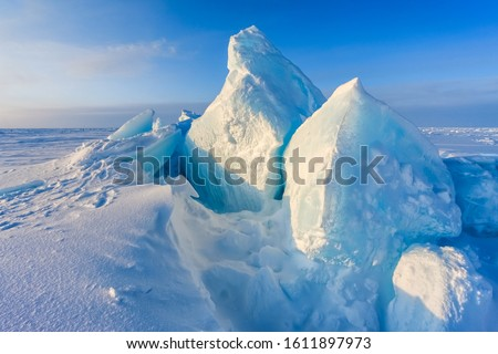 Arctic background. North pole. Beautiful colors of polar ice. Big Floes. Glaciers. Snowy landscape on blue sky and sunshine rays. Development Of The Arctic.  #1611897973