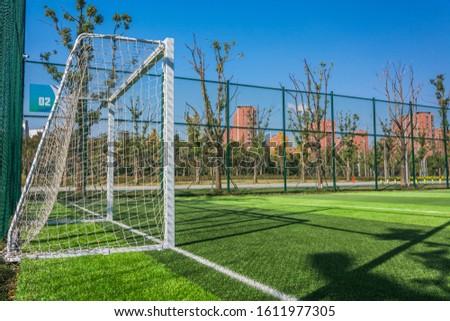Panoramic view of soccer field stadium and stadium seats #1611977305