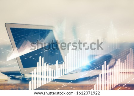 Forex Chart hologram on table with computer background. Multi exposure. Concept of financial markets. #1612071922