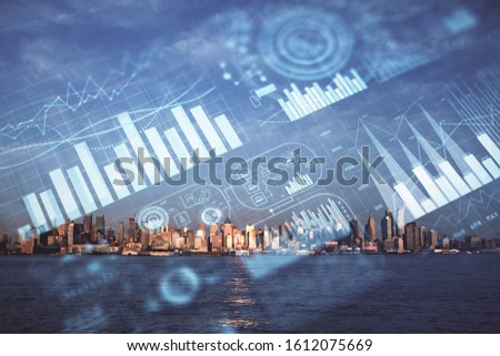 Forex chart on cityscape with skyscrapers wallpaper double exposure. Financial research concept. #1612075669