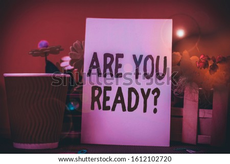 Word writing text Are You Ready Question. Business concept for used telling someone start something when feel prepared Flowers and stationary plus plain sheet with paper big cup above a table. #1612102720