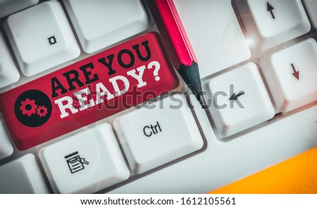 Conceptual hand writing showing Are You Ready Question. Business photo showcasing used telling someone start something when feel prepared White pc keyboard with note paper above the white background. #1612105561