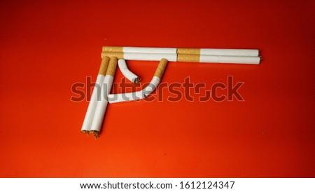 Cigars drawing a gun , symbolizing death . #1612124347