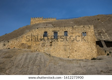 Sperlinga Sicily Italy December 2019 outside view of the medieval fortification built on a high rock, some windows, rooms and the main tower of the castle #1612273900