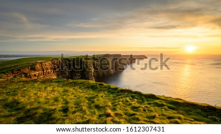 Moher cliffs and atlantic ocean in Ireland Royalty-Free Stock Photo #1612307431