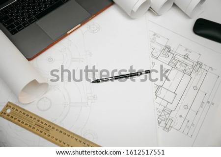 Engineering drawings, protractor, notebook, term paper or diplom