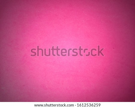 Bright pink background, close to lilac and fuchsia. Dark light vignetting around the edges. Background, greeting card or declaration of love.