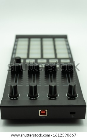 midi controller for disc jockey,sound producer & composer.Create electronic musical tracks with modern digital beat machine with knobs and pads isolated on white background, music concept #1612590667