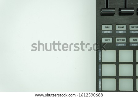 midi controller for disc jockey,sound producer & composer.Create electronic musical tracks with modern digital beat machine with knobs and pads isolated on white background, music concept #1612590688