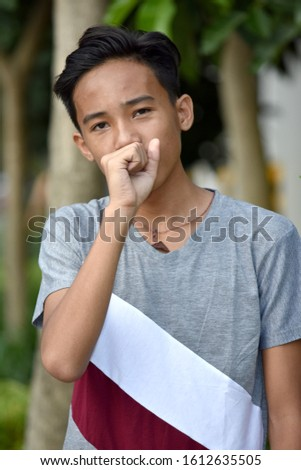 A Coughing Minority Teenage Male #1612635505