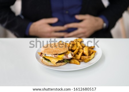 Mid Age Man Suffering From Stomach Pain While Having Breakfast #1612680517