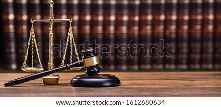 Wooden Gavel With Golden Scale On Table #1612680634