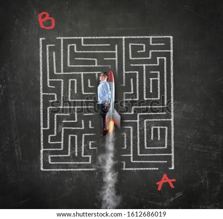 Young businessman flying with a rocket through a maze . Solving the maze shortcut concept. Point a to point b maze. Royalty-Free Stock Photo #1612686019