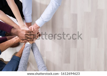 Close-up Of Many Hands Lying On Top Of Each Other #1612694623