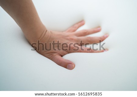 Hand Testing Orthopedic Memory Foam Core Mattress Royalty-Free Stock Photo #1612695835