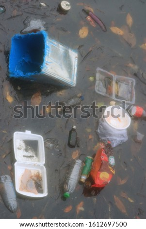 Water pollution. Oil, plastic and dead fish in heavily polluted ocean #1612697500
