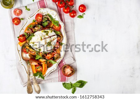 Buffalo burrata cheese with fresh raw tomatoes and basil leaves #1612758343