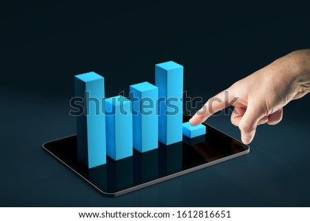 Costs reduction app concept, costs cut, costs optimization business concept. Businessman press costs down represented by graph placed on digital tablet. #1612816651