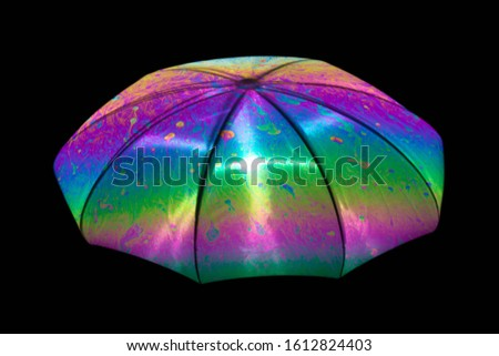 Reflection of an umbrella on the surface of a soap bubble with an interference pattern. #1612824403