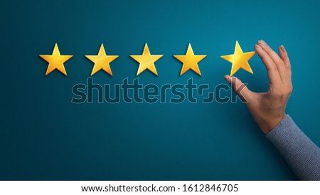 Evaluation concept. Business woman holding five star to increase rating of company, panorama, copy space Royalty-Free Stock Photo #1612846705