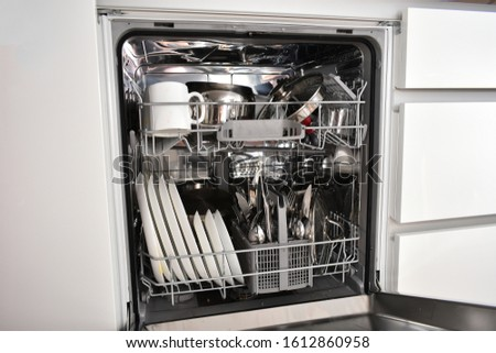 Dirty dishes in the dishwasher #1612860958