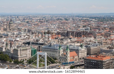 Downtown (Ferenciek square) of Budapest, Hungary from above. Rooftop view with buildings, church towers and colorful rooftops. European capital city skyline. #1612894465