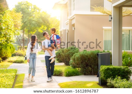 Asian family go to school together, this image can use for education, father, mother, daughter, student and preschool concept #1612896787