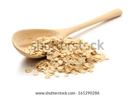 Heap of rolled oats with wooden spoon on white #161290286