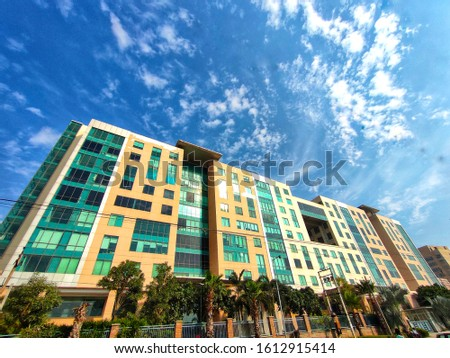 Office company building architecture outdoor exterior technology based companies includes nature and beautiful blue sky clouds with full wide angle landscape business tower #1612915414