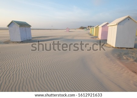 Some wooden cabin on the beach of Berck in the north of France. #1612921633