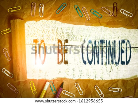 Handwriting text writing To Be Continued. Concept meaning indicate that the story continues in the next episode Stationary and torn cardboard placed above a wooden classic table backdrop. #1612956655