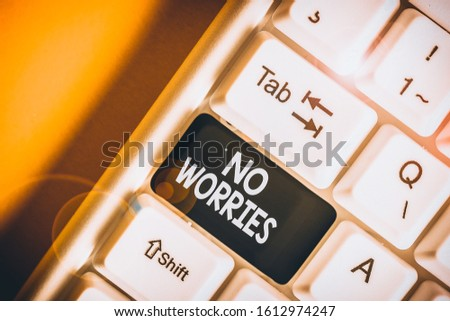 Text sign showing No Worries. Conceptual photo an expression used to say that everything is all right White pc keyboard with empty note paper above white background key copy space. #1612974247