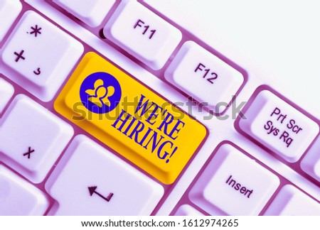 Handwriting text We Re Hiring. Concept meaning recently employ someone or pay him to do particular job White pc keyboard with empty note paper above white background key copy space. #1612974265