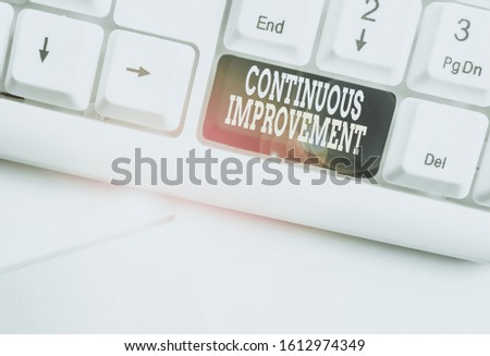 Handwriting text Continuous Improvement. Concept meaning ongoing effort to improve products or processes White pc keyboard with empty note paper above white background key copy space. #1612974349
