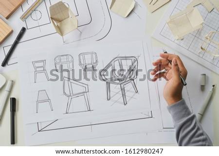Designer sketching drawing design development product plan draft chair armchair Wingback Interior furniture prototype manufacturing production. designer studio concept .                            #1612980247
