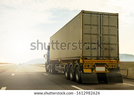 Cargo Truck on highway road with container, transportation concept.,import,export logistic industrial Transporting Land transport on the expressway againt sunrise sky #1612982626