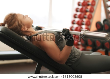caucasian female with  dumbbells in gym #1613003608