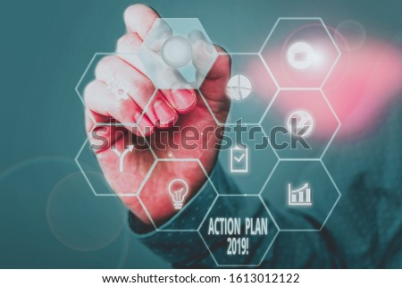 Handwriting text Action Plan 2019. Concept meaning proposed strategy or course of actions for current year Picture photo system network scheme modern technology smart device. #1613012122
