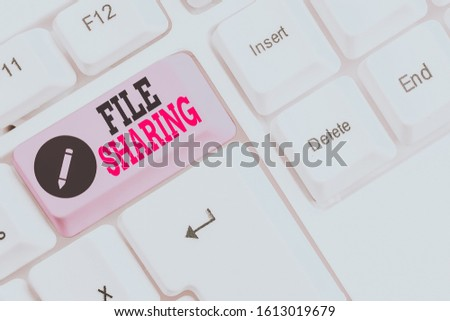 Text sign showing File Sharing. Conceptual photo transmit files from one computer to another over a network White pc keyboard with empty note paper above white background key copy space. #1613019679
